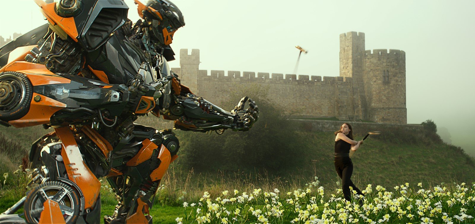 Left to right: Hot Rod and Laura Haddock as Viviane Wembly in TRANSFORMERS: THE LAST KNIGHT, from Paramount Pictures.